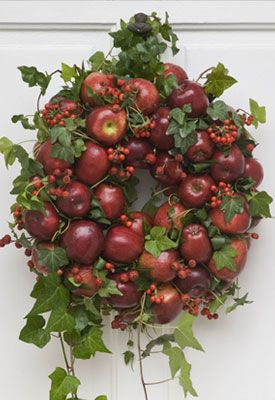 Apple and berry wreath with a natural accent... This would look great as a centerpiece with a candle in the center!