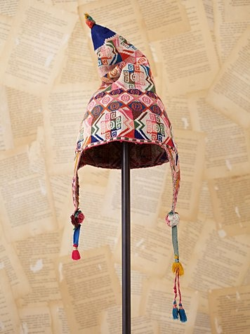 Vintage Bolivian Knit Hat  Style: 23820624  Beautiful vintage Bolivian hand knit hat with ear flaps and tassels. Colorful pattern all over.