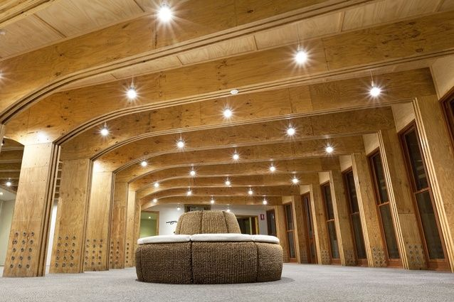 Inside the earth-covered building, laminated veneer lumber meets a massive structural challenge.