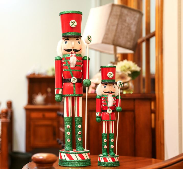 Handmade Christmas Nutcracker Wooden Walnut Soldiers  Traditional Walnut Soldiers have a wooden leaver at the back for mouse. Protecting your family and Good luck to your family. Glitter and Vintage design Nutcrackers are gorgeous table ornaments as well.  Size: 30cm Height (12 inches),61cm Height(24 inches)             Material: Wooden  Attention: Glitter will dropping a little bit  during its delivery. It will no longer dropping when you place it.  Thank you for visiting our shop.