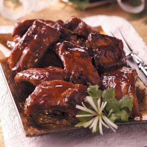 "Honey Garlic Ribs Recipe -When you want a more ""meaty"" appetizer for your holiday buffet, reach for these finger-licking-good ribs!"
