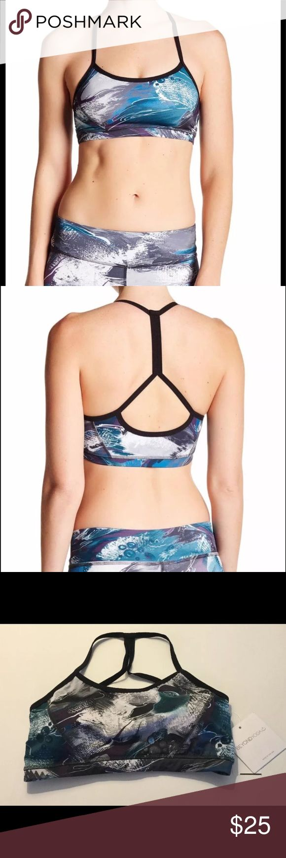 Beyond Yoga Lux Keyhole Back Sports Bra XS XL Print is called Winter Store. Removable bra pads Skinny strap racerback Supplex shelf bra Open back detail Medium support Quick drying 4-way stretch 82% polyester, 18% lycra Beyond Yoga Intimates & Sleepwear Bras