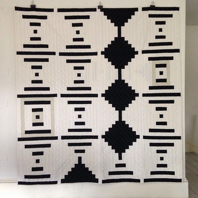 """This is such a fantastic """"Courthouse Steps"""" variation by Alexis Deise. I especially like the strips of grey fabric that make an appearance in a few of the blocks."""