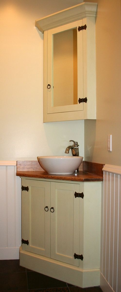Angled corner bathroom vanity  Lower has wood counter top and oversize  furniture style baseboard  Upper with mirrored door and large crown  molding  B. 17 Best ideas about Corner Sink Bathroom on Pinterest   Corner