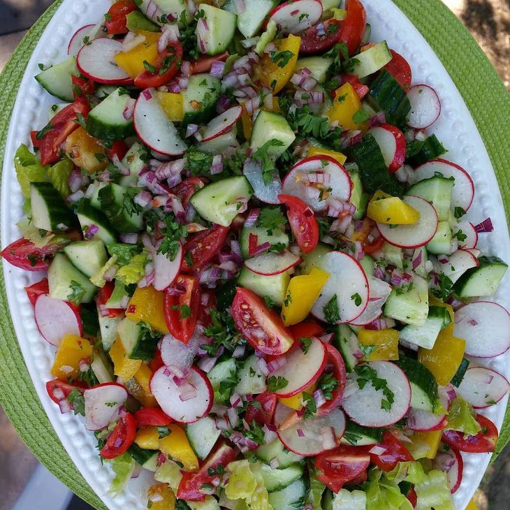 Summer Garden Detox Salad Recipe Salads with cucumber, cherry tomatoes, garlic, yellow bell pepper, radishes, purple onion, romaine lettuce hearts, apple cider vinegar, extra-virgin olive oil, fresh parsley, pepper, sea salt