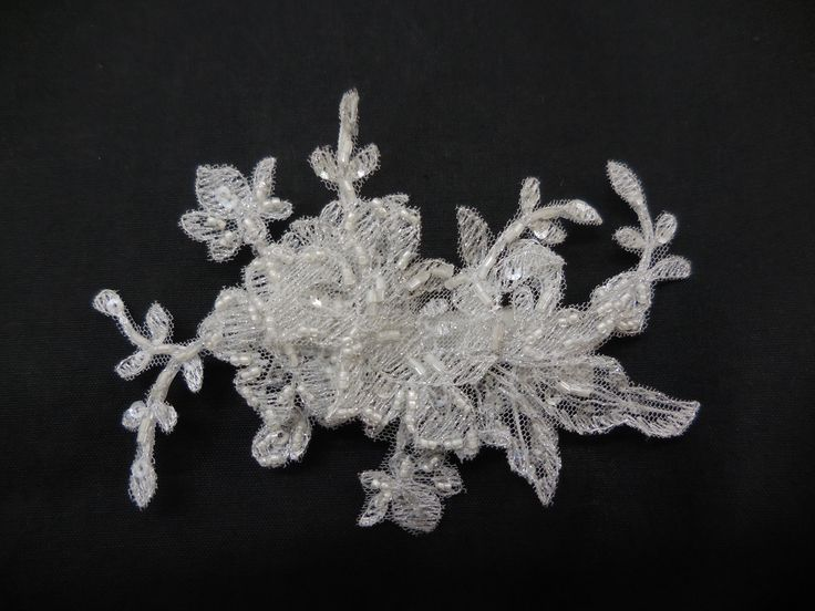 At Caleche we love our lace accessories. We can produce lace headpieces to match our wedding gowns so that our brides have the perfect accessories.