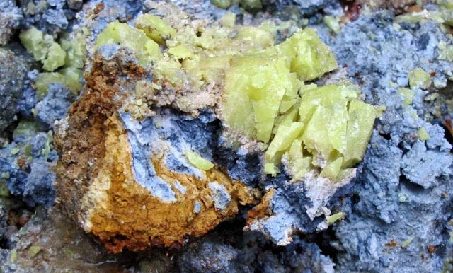 Nodule of Oregon blue clay, coated with red clay and sulfur crystals encased in white clay.  Clay Mineral Waters Earth's Mantle From the Inside