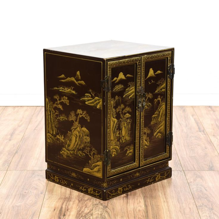 This Asian cabinet is featured in a solid wood with a glossy black paint finish. This bar buffet has intricate gold painted chinoiserie details with natural scenery, 2 doors and a large interior cabinet space with shelving. Perfect for storing drinks and dishes!  #asian #storage #cabinet #sandiegovintage #vintagefurniture