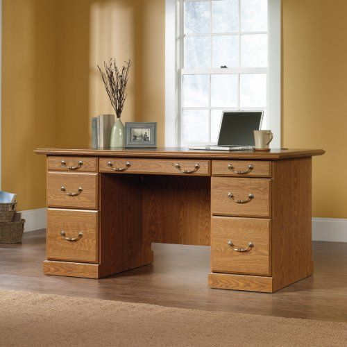 Sauder Orchard Hills Executive Desk by Sauder. $329.95. Sauder Orchard Hills collection executive desk is constructed of dense engineered wood with a durable laminate finish in Carolina Oak. Traditional American country style provides endless versatility with finely detailed moldings, raised panel doors, and brassfinish hardware. Executive desk features a flipdown moulding reveals a slideout keyboard/mouse shelf with metal runners and safety stops. Desk has three u...
