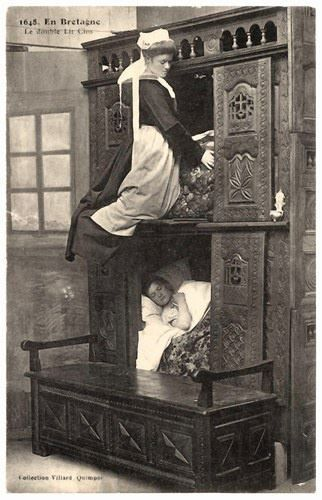 A box-bed is a bed enclosed in furniture that looks like a cupboard, half-opened or not.The box-bed is closed on all sides by panels of wood. One enters it by removing curtains, opening a door hinge or sliding doors on one or two slides. In front of the box-bed was often a large oaken chest, with the same length as the bed. This was the 'seat of honour,' and served also as a step for climbing into the bed. It was also used to store clothing, underwear and bedding the rest of the time