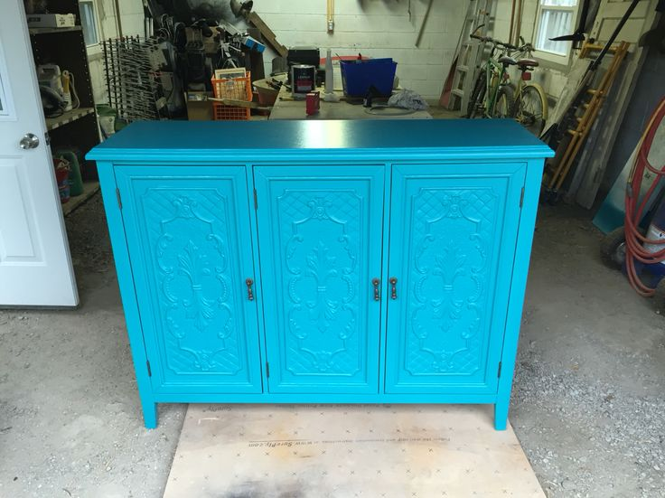 Turquoise Cabinet: We properly de-glossed and shellac primed the cabinet and finished in a satin waterborne lacquer all by HVLP spray.