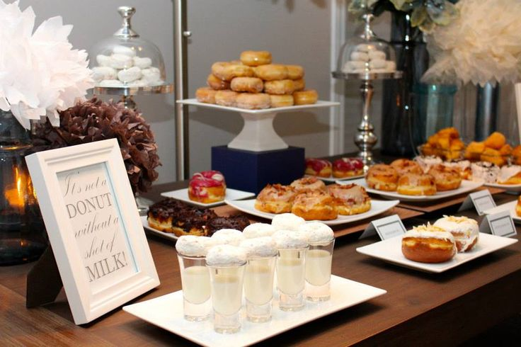 Dessert table with a masculine twist. This is the perfect dessert table for the man in your life. Donuts are so versatile and were the perfect choice to celebrate this birthday. Don't forget to take a shot!