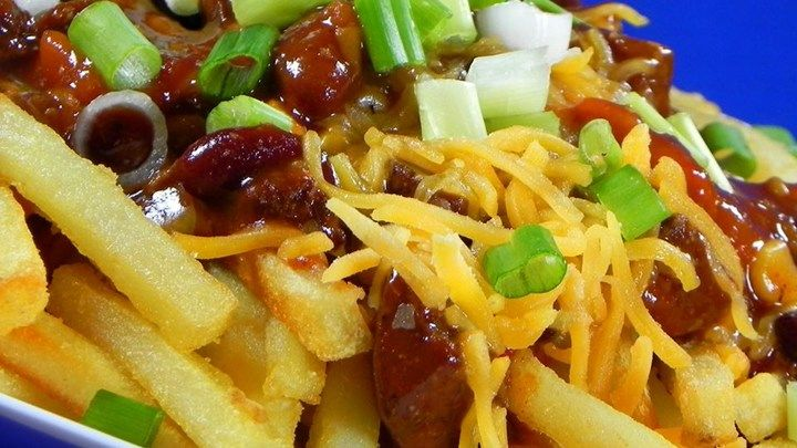 Smothered in chili and cheddar cheese sauce, these easy chili cheese fries are a complete meal in themselves.