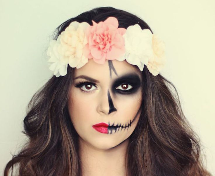 """Halloween is alright, but Día de los Muertos is as cool of a holiday as it gets. Also known as """"The Day of the Dead,"""" this holiday is a Mexican tradition that honors the dead and brings family together for food and celebration. Women traditionally paint their faces to resemble skull candy, and they wear vibrant flower crowns. While the holiday itself isn't until November 1, these Día de los Muertos makeup ideas are perfect asa Halloween costume for womenwho want to be beautifulandspooky…"""