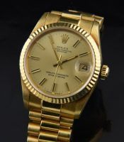 Rolex solid 18k. gold mid-size Datjust....very hard to find!