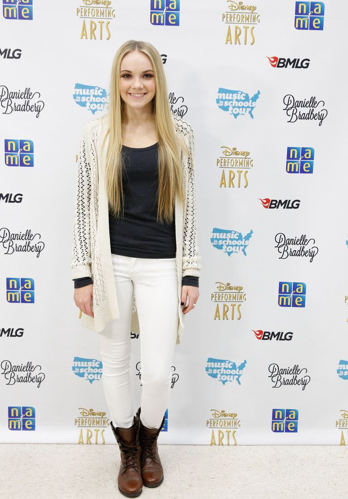 Danielle Bradbery Photos: Danielle Bradbery Performs in Tennessee. I like her outfit here- the black, cream, and white make for a cute combo. I don't care for the boots as much, but she pulls it off well.