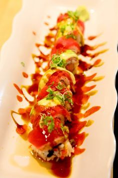 """My favorite Sushi Roll! """"Burning Man"""" sushi roll consisting of spicy tuna and crunchy inside, peppered tuna and avocado outside, eel sauce, ponzu and scallion topping. 2 DIE!"""