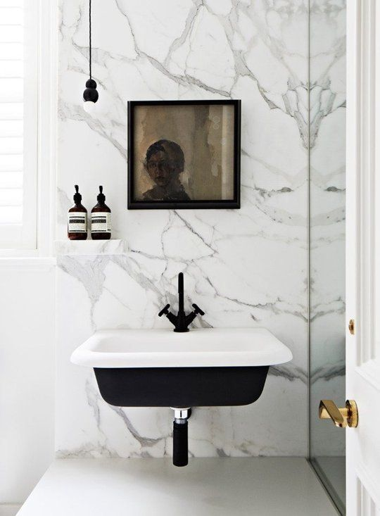 Unique and chic - a black bottomed sink. I would probably change the handles to a brass or gold fixture!