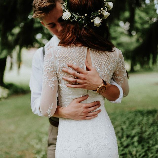 Bohemian bride wearing flower crown and lace dress