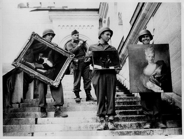 James Rorimer with Nazi-looted art by sokref1, via Flickr  At Schloss Neuschwanstein in southern Bavaria, Captain James Rorimer, who later would become the director of the Metropolitan Museum of Art, supervises the safeguarding of art stolen from French Jews and stored during the war at the castle (April-May, 1945). Photo Source: National Archives and Records Administration