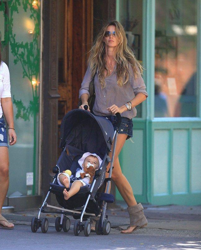 Gisele Bundchen, tan top, denim shorts, jean shorts, cutoff shorts, tan sandals, suede sandals, bracelets, sunglasses, tote bag,