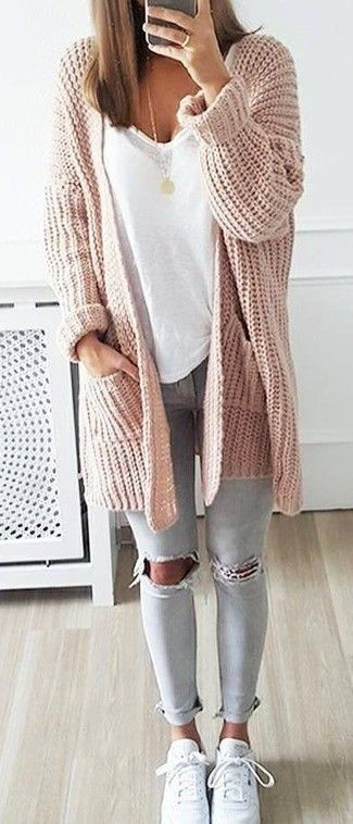 pink knit cardigan with an open front, white t-shirt with a v-neck, gray tight jeans with destroyed effects, white leather low sneakers for women