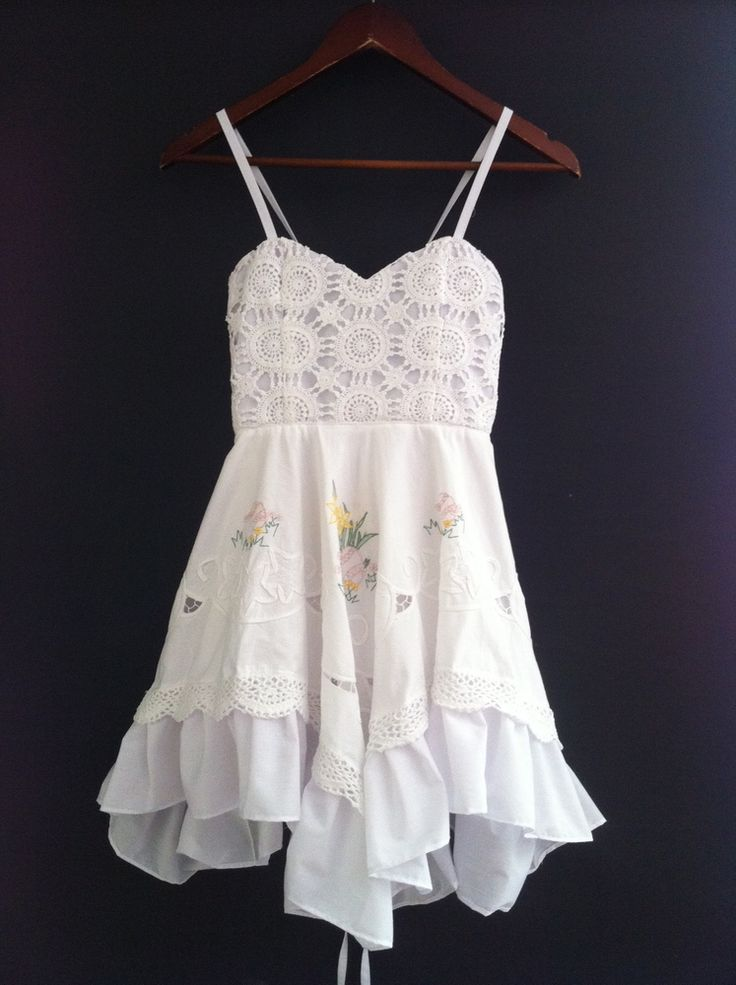 Divinity and Grace White Gypsy Dress.Beautiful hand made dress from vintage laces and fabrics.The sweetheart neckline is very flattering with the bustier section made from lovely crochet cotton. Back is open and does up like a corset giving you a perfect fit and bust support. The dress is fully lined in quality cotton.Skirt is made from white cotton featuring a cute embroidery and lace trim with extra frill. Multi length hem and a full circle skirt make this dress so much fun!...