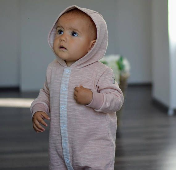 ORGANIC FRENCH TERRY BLUSH MELANGE OVERALL WITH A HOODIE Made from premium GOTS certified French Terry - smooth on the outside with a looped back. The fabric resilient but stretchy and soft too due to its texture. Featuring contrasting front opening with snap fasteners for easy dressing