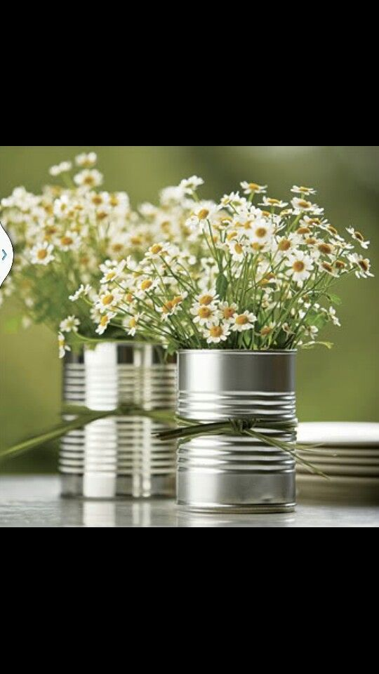 Simple Aluminum Can Table Centerpieces........Tie can with Burlap, Lace or Rafia........so frugal!