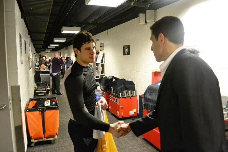 Sidney Crosby shaking Marcel Goc