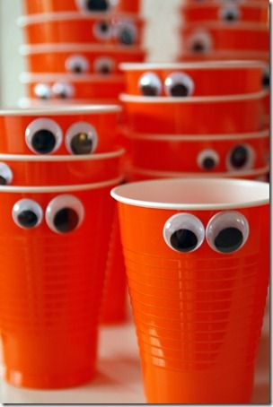 Just glue or ... use double sided sticky tape to put some wiggly eyes on to plastic cups for ANY fun event. Eyes are found at dollar stores and craft stores.:
