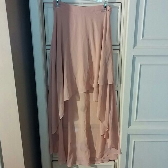 Blush colored high low skirt NEVER WORN Cute blush colored shear high low skirt with slip Skirts High Low