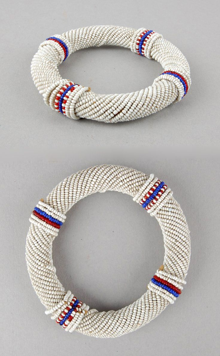 Africa | Tubular wristlet; rolled vegetal fiber, covered in glass beads.  Possibly from South Africa | ca. 19th - 20th century