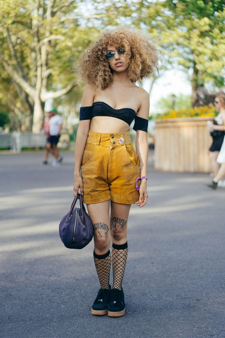 Balance out some high-waisted shorts with a sexy bra top and fishnet socks. #refinery29 http://www.refinery29.com/2016/07/117807/panorama-festival-street-style-2016#slide-4