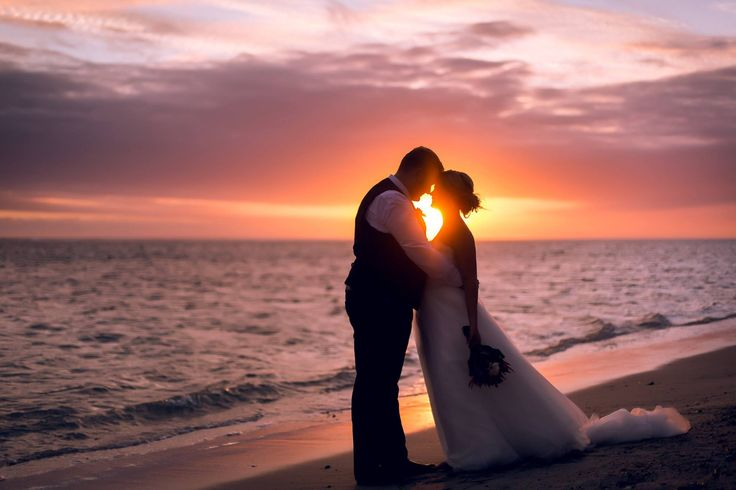 Outrigger Fiji Beach Resort Wedding Ideas Planning Inspiration Tropical Paradise Style Floral Design Planning Photography Magical Silhouette Couple Sunset Shot