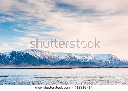 Mountain with snow in the ocean in Iceland