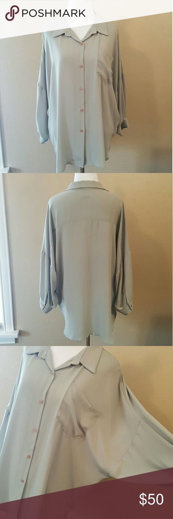 """Stella McCartney blouse *Price is firm* Button down blouse Dusty green batwing top, floppy and oversized, breast pocket  Tags missing Approximately size medium 28"""" long. 22"""" sleeve. 26"""" batwing bust. 22"""" waist. 20.5"""" hips.  Excellent condition  Material unknown, feels like polyester/blend Authentic Stella McCartney Tops Blouses"""