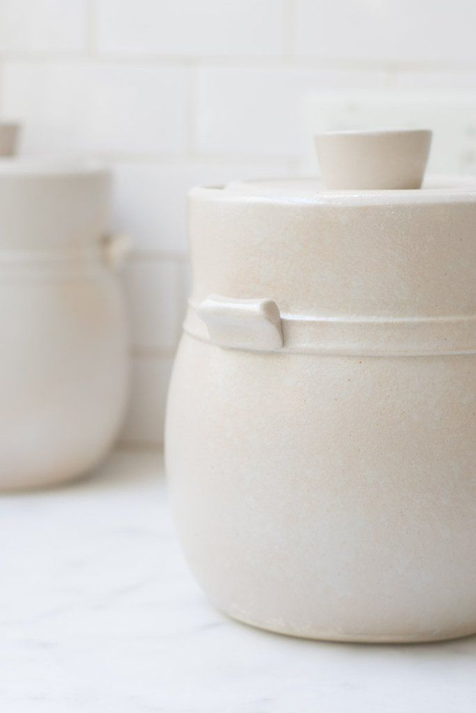 Fermentation Crock - Matte White Fog - These fermentation crocks are special - functional pottery at its best. Each piece is made with high-fired stoneware and glazed by hand for a nontoxic surface that is resistant to corrosion. The glaze is a slightly cool-toned shade of white, with a scattering of tiny cinnamon-colored freckles and a barely textured finish. - from QUITOKEETO.com
