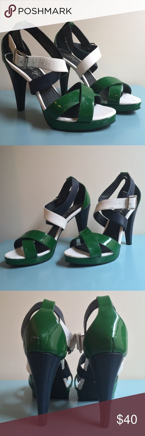Navy Green and White Strappy Heels These shoes were originally custom made. They have  emerald green, navy blue, and white aspects. The shoe is clearly worn as can be seen in the pics, with some stains and scratches. Theyre high quality shoes though. Shoes Heels