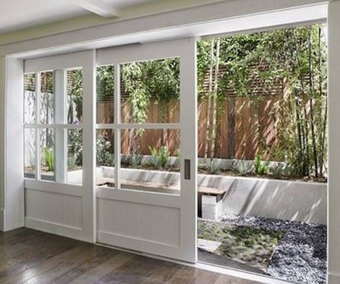 White sliding exterior pocket doors 700 584 for Exterior sliding pocket doors