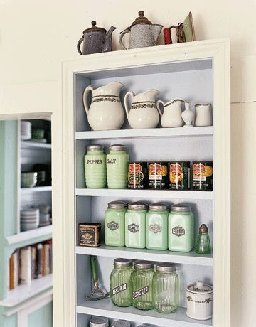 A recessed shelving unit provides storage in a shallow for Country kitchen storage ideas