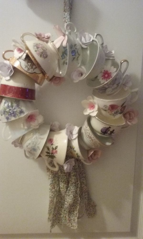 Next time you're at the thrift store, buy some tea cups and copy this woman's gorgeous front door idea!