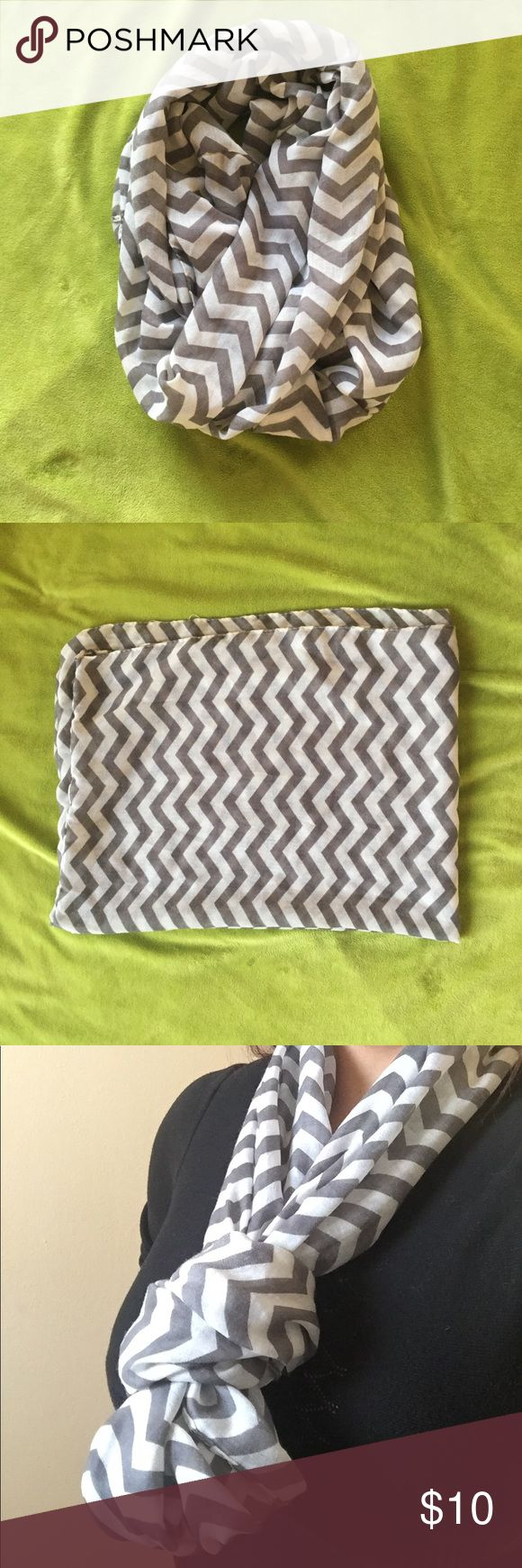 White and gray Chevron infinity scarf Soft and versatile infinity scarf in a classic chevron pattern makes a great gift. Great condition - no stains. Accessories Scarves & Wraps
