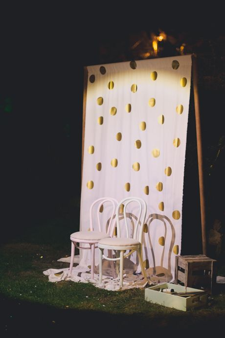 Gold polka dot photobooth by Spread Love Events