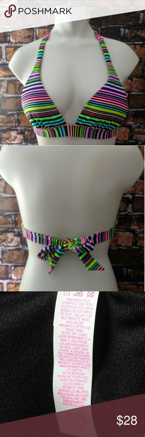 Victoria's Secret Bikini Top Multi Color This VS bikini top has multi colored stripes with removable padding. Ties in back and at neck. This item is a VS return or overstock that has the VS label cut out to prevent store returns. Victoria's Secret Swim Bikinis