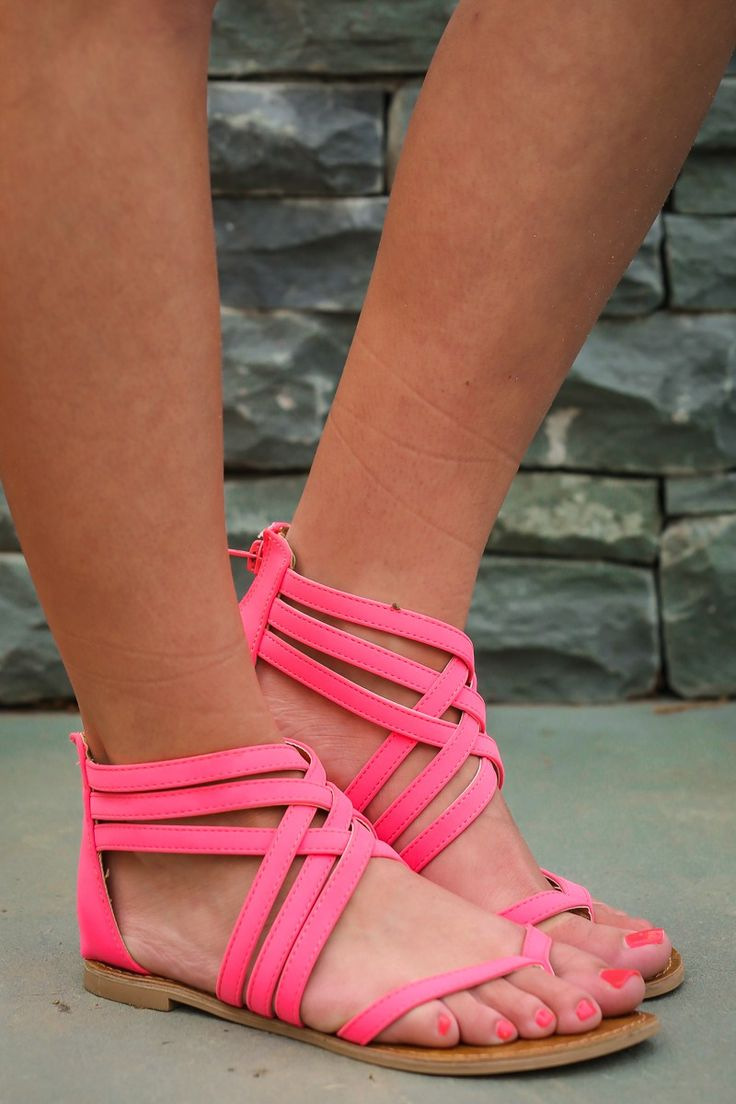 These fine Pink Thong Sandals are perfect for some Day Trippin'. Walking around your town or visiting somewhere new, you'll be cute and comfortable in these strappy sandals. Strappy caged thong sandals with a zipper on the heel cup.   •Rubber sole • Vegan friendly, man made materials • Imported