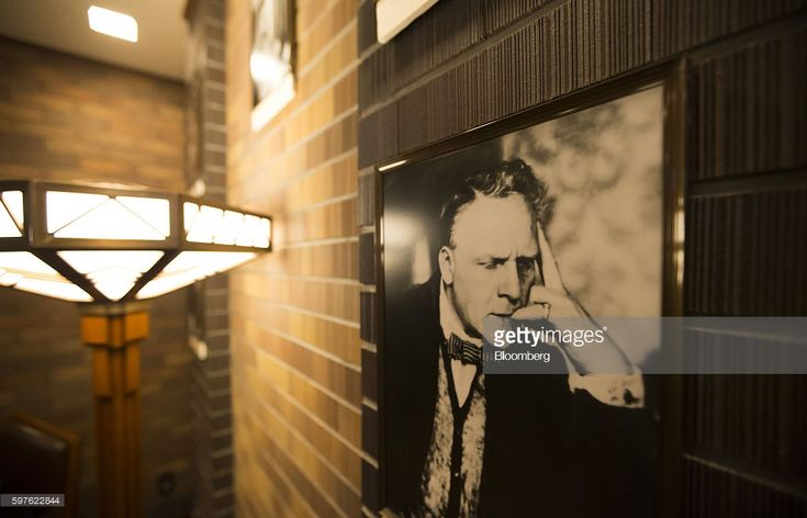 A portrait of Feodor Ivanovich Chaliapin, a Russian opera singer, is displayed inside the Old Imperial Bar at the Imperial Hotel in Tokyo, Japan, on Friday, Aug. 19, 2016. Tokyo's Imperial Hotel, the luxury inn that counts Marilyn Monroe among past guests, raised room rates last year to levels it last charged before Japan's bubble burst in the early 1990s. A surging yen now threatens those gains.