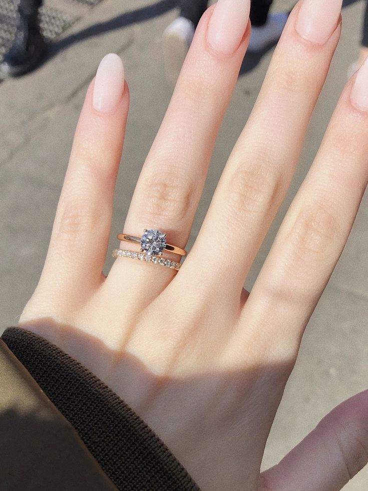 1.25CT solitaire paired with a diamond eternity band is the sleekest look
