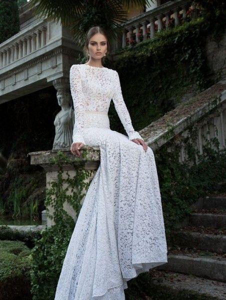 Vestido de novia con manga larga y confeccionado en encaje