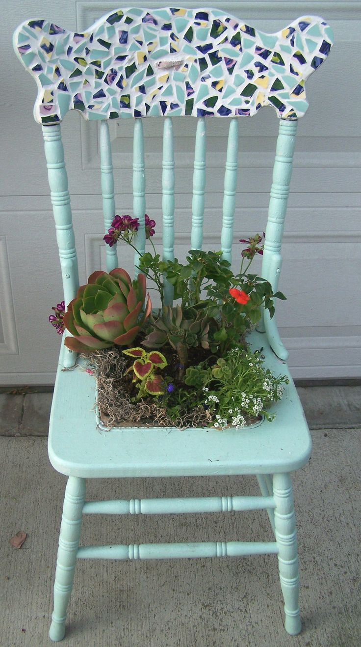 Here is my first attempt at making my own yard art. I found this chair by the curb, painted it, broke some dishes for mosaic and planted a garden. I like it!